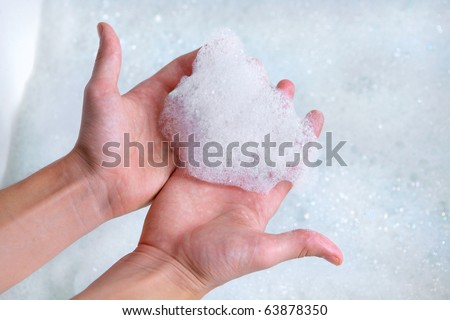 clean male hands washing with soap foam bubbles - stock photo