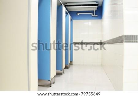 clean male public toilet room - stock photo