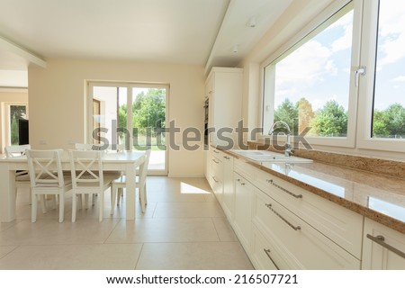 Clean modern kitchen interior in new house - stock photo