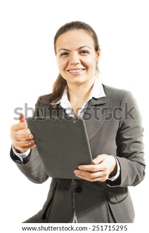 Clean modern portrait of a mature professional business woman with ample copy space. Isolated on white background. Woman using digital tablet computer PC, happy.