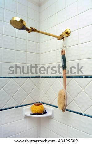 Clean New Shower Room with a brush hanging on the shower head. - stock photo