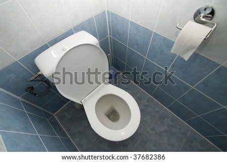 clean open toilet photo, tiled walls and floor