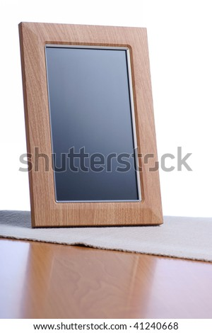 clean photo frame on the table in white background - stock photo