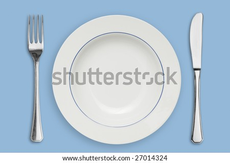Clean placed plate with fork and knife, ready for dinner!