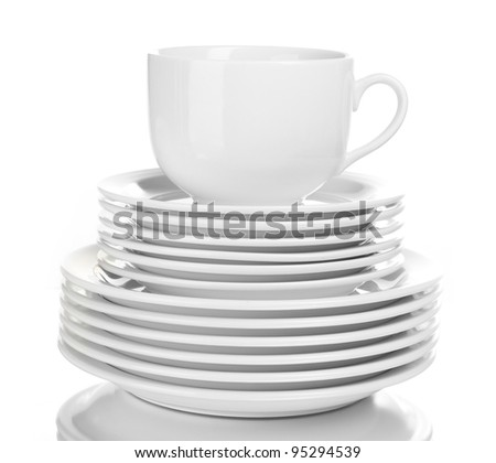 Clean plates and cup isolated on white - stock photo