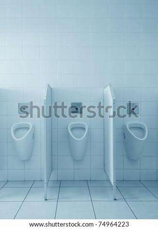 Clean public men toilet room, wc - stock photo