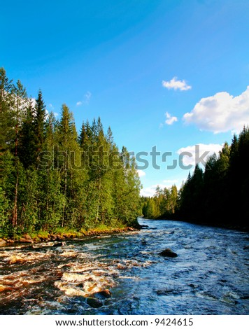 Clean rapids in the north of Sweden - stock photo