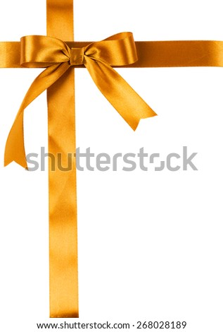 clean sheet is tied up by a golden satin ribbon with a bow - stock photo