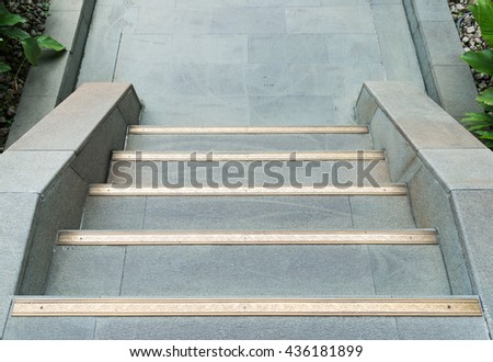 Clean stone staircase with golden strip in the Chinese temple. - stock photo