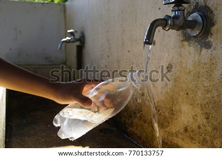 Clean The Pet Bottle With Tap Water At Outside Garden