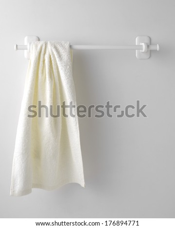 Clean towel on a hanger - stock photo