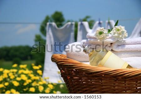 Clean towels freshly folded in wicker basket - stock photo