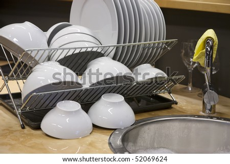 Clean, washed dish drying - stock photo