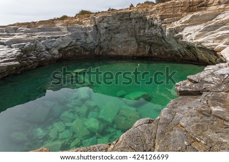 Clean waters of Giola Natural Pool in Thassos island, East Macedonia and Thrace, Greece  - stock photo