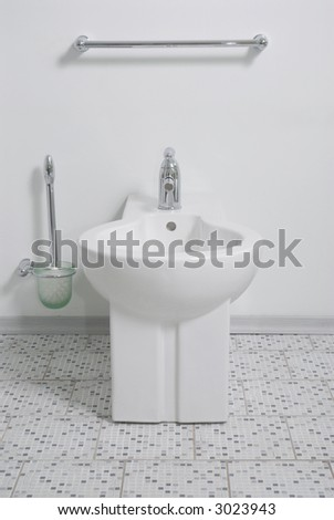 Clean white lavatory pan and toilet accessorys - stock photo