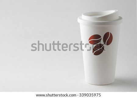 Clean white to go coffee with coffee beans logo cup isolated on white background with space for text - stock photo