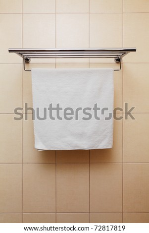 Clean white towel on a hanger - stock photo