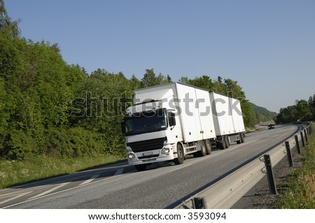 clean white truck coming head on, freeway in the country - stock photo