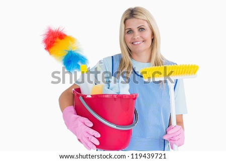 Cleaner holding a bucket with a broom in the white background - stock photo