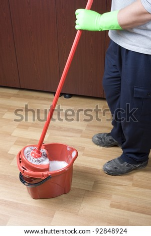 cleaner mopping floor in office - stock photo
