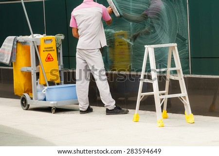 Cleaner with cleaning in process - stock photo