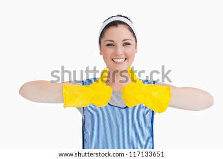 Cleaner woman thumbs up with yellow gloves on the white background