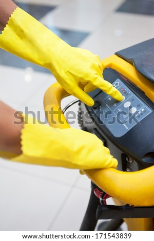 Cleaner workers with mop in uniform cleaning floor - stock photo