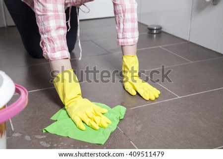 Cleaning a floor - stock photo