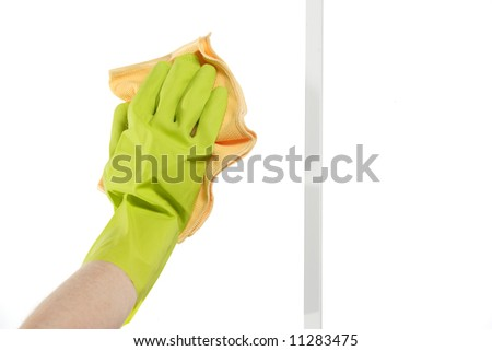 Cleaning a window by hand with a rag - stock photo