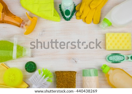 Cleaning and housework concept on wooden background, copyspace in center - stock photo