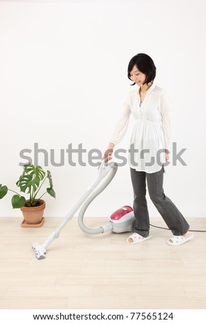 Cleaning asian women - stock photo