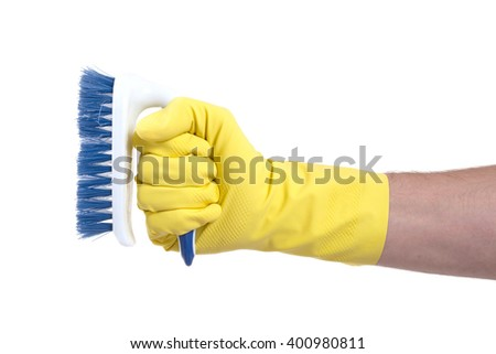 Cleaning brush in hand isolated on white - stock photo