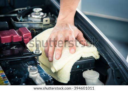Cleaning car engine with with a fabric,serviceman