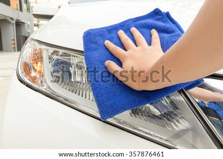 cleaning car using microfiber cloth concept