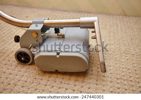 Cleaning carpet with commercial cleaning equipment - stock photo