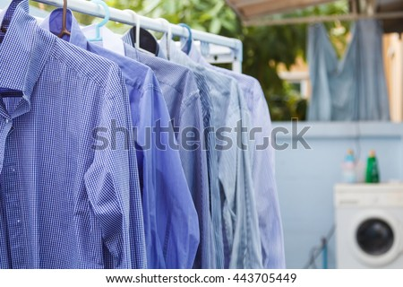 Cleaning clothes wait for dry with washing machine background