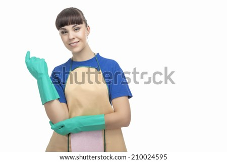 Cleaning Concept: Adorable Caucasian Female Cleaner with Protective Rubber Gloves On. Horizontal Image - stock photo