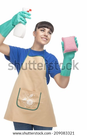 Cleaning Concept: Caucasian Woman Spraying Liquid Cleaner Over the Sponge and Smiling.  - stock photo