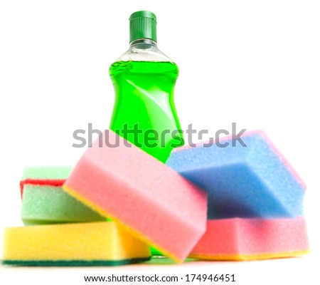 Cleaning detergent with sponge over white background. - stock photo