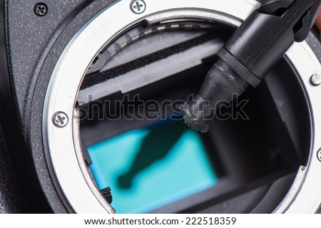 cleaning dirty camera sensor (CCD or Cmos) - stock photo