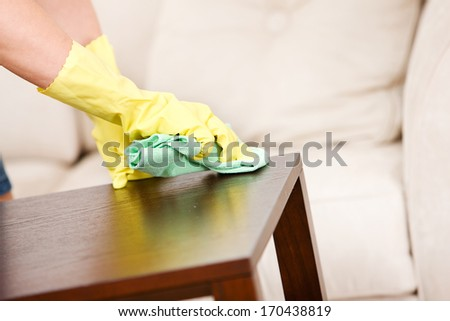 Cleaning: Dusting A Table.