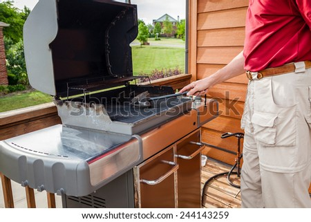 Cleaning grill - stock photo