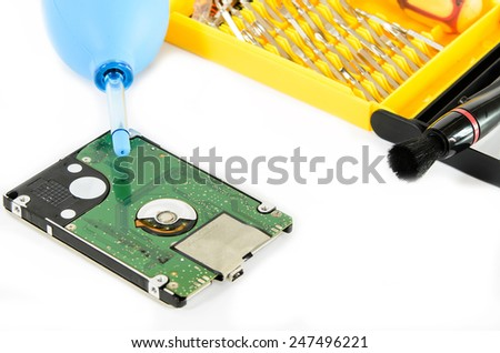 Cleaning Hard Disk on White Background - stock photo