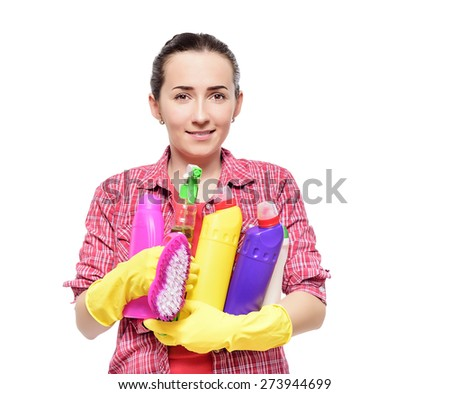 Cleaning lady holding basin with cleaning supplies, against white background. - stock photo