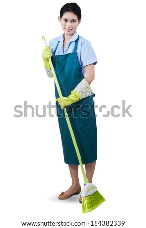 Cleaning lady using a broom to sweeping the floor - stock photo