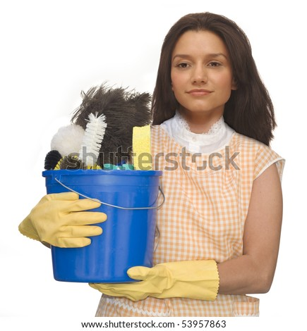 Cleaning lady wearing rubber gloves and an apron holding a bucket of cleaning supplies on a white background - stock photo