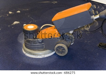 cleaning machine washing an office carpet - stock photo