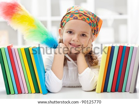 Cleaning my room - little girl with duster brush - stock photo