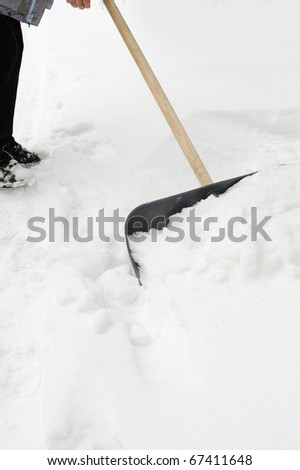 Cleaning of a snow. Clearing of road to winter time by means of a shovel - stock photo
