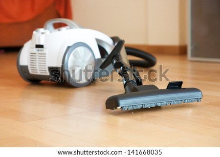 Cleaning of the apartment. Vacuum cleaner on the floor - stock photo
